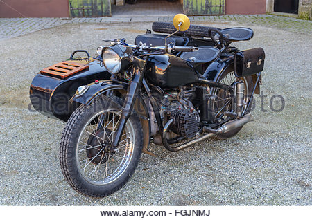 Old motorbike with sidecar in black. Retro style transportation - Stock Photo