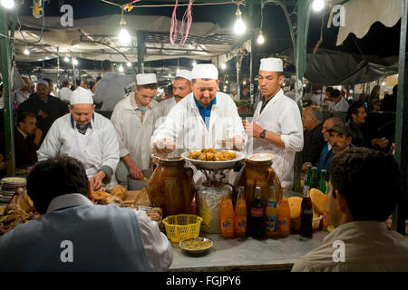 Chefs cooking food in Jemaa El Fna Square in Marrakech Morocco - Stock Photo