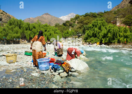 Washing clothes in the river at Setti Fatma, Ourika Valley Morocco - Stock Photo