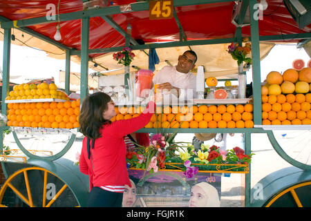 Freshly squeezed cool orange juice, in Marrakech Morocco. - Stock Photo