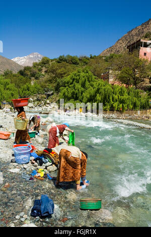 Washing clothes in the river at Setti Fatma, Ourika valley Marrakech Morocco - Stock Photo