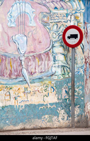 Truck lorry road traffic sign in front of street art mural murals on wall at Havana, Cuba, West Indies, Caribbean, - Stock Photo