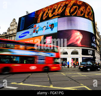 London Bus and Taxi passing Picadilly Circus London - Stock Photo