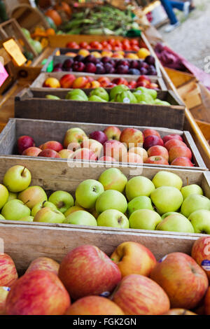 Crates of apples, plums and peaches are on display at a farmer's roadside stand market in northern Michigan. Crisp - Stock Photo