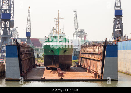 Ship in a dry dock for repairs - Stock Photo