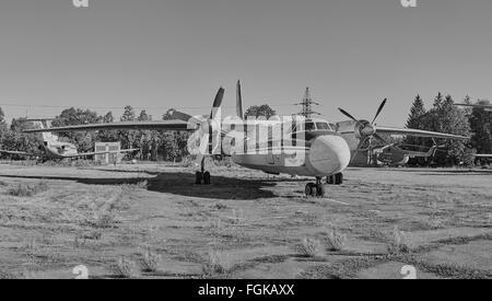 KRIVOY ROG, UKRAINE - FEBRUARY 3, 2016: Panoramic view of old soviet aircraft An-24 Antonov at an abandoned aerodrome - Stock Photo
