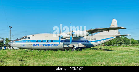KRIVOY ROG, UKRAINE - FEBRUARY 3, 2016: Panoramic view of old soviet aircraft An-12 Antonov at an abandoned aerodrome - Stock Photo