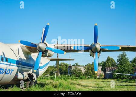 KRIVOY ROG, UKRAINE - FEBRUARY 5, 2016: Turbines of turboprop old soviet aircraft An-12 at an abandoned aerodrome - Stock Photo