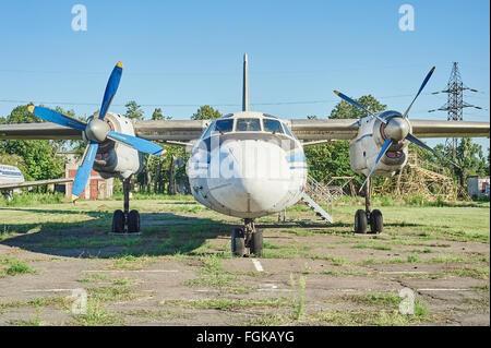 KRIVOY ROG, UKRAINE - FEBRUARY 5, 2016: Panoramic view of old soviet aircraft An-24 Antonov at an abandoned aerodrome - Stock Photo