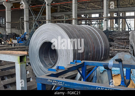 Rolls of steel sheet in a plant - Stock Photo