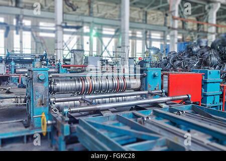 machine for slitting steel sheet. Tilt-shift effect. - Stock Photo