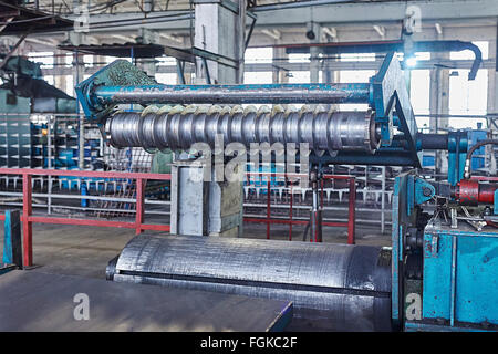 machine for slitting steel sheet - Stock Photo