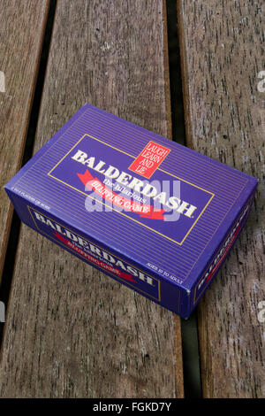 Balderdash bluffing board game on a wooden background - Stock Photo