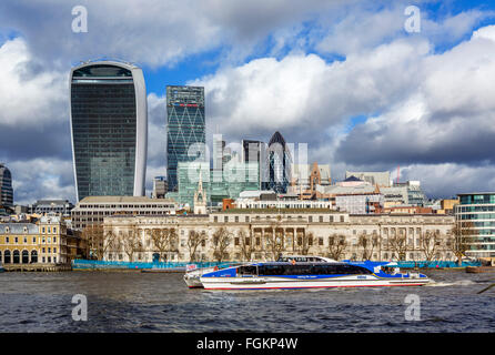 View over the River Thames to the City of London with Custom House and MBNA Thames Clipper in foreground, London, - Stock Photo