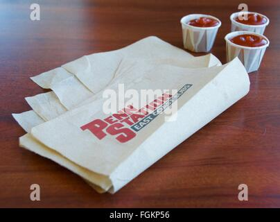 Penn station napkin with ketchup cups in background - Stock Photo