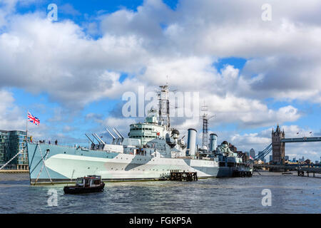 HMS Belfast, a museum ship moored on the River Thames near Tower Bridge, London, England, UK - Stock Photo