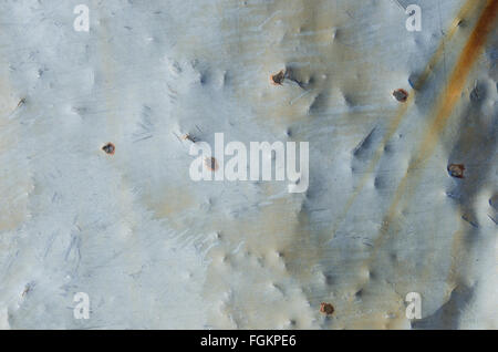 Bullet holds in aged sheet metal background image - Stock Photo