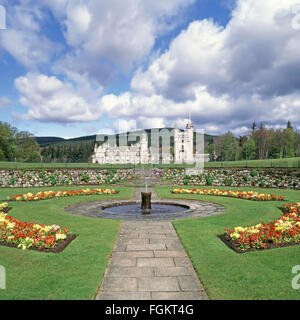 Victorian Balmoral Castle Royal Estate House & garden landscape with small fountain near village of Crathie Royal - Stock Photo