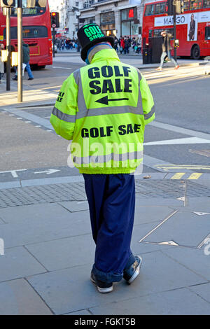 Golf Sale advertising by person standing on Regents Street London pavement wearing high vis jacket to advertise - Stock Photo