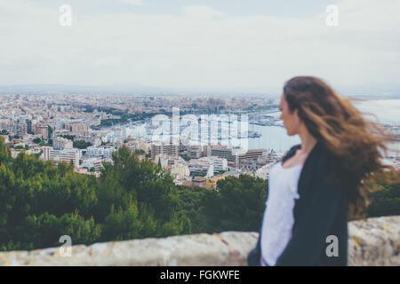 Woman looking down at the City of Palma - Stock Photo