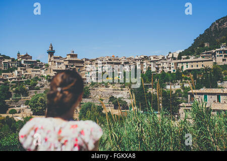 Young woman looking to Valldemosa old town - Stock Photo
