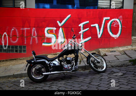 La Paz, Bolivia, 20th Februrary 2016. A parked Regal Raptor motorbike in front of a campaign slogan showing support - Stock Photo
