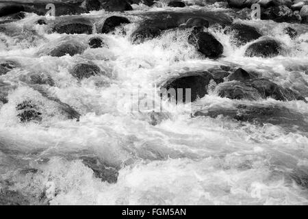 The rushing water of the river flowing down from the high mountains of Hatcher Pass in Alaska - Stock Photo