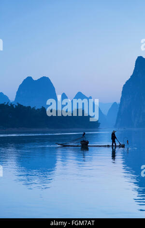 Cormorant fisherman on Li River at dawn, Xingping, Yangshuo, Guangxi, China - Stock Photo