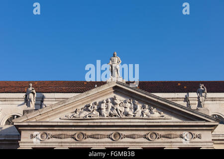 Pediment of Dona Maria II National Theater in Lisbon, 19th century Neoclassical style. - Stock Photo