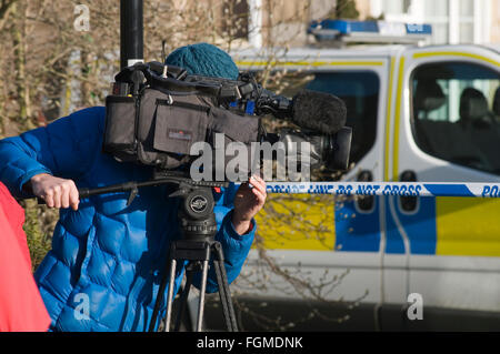 tv news crew camera man men cameraman cameramen gathering local national television broadcast broadcasters worthy - Stock Photo