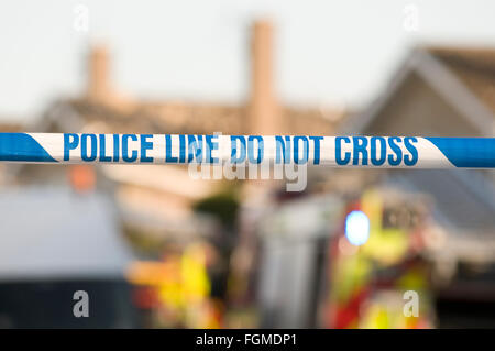 police line do not cross tape crime scene scenes investigation investigations criminal activity accident cordon - Stock Photo