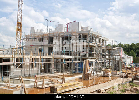 Construction site with crane and a new building - Stock Photo