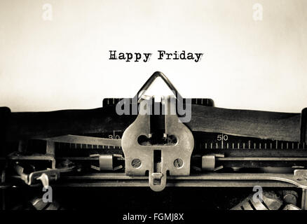 Happy Friday message typed on a vintage typewriter - Stock Photo