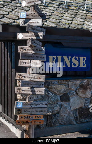 At Finse Trainstaion, highest situated station on Oslo-Bergen railway. Touristic information, signpost to huts, - Stock Photo