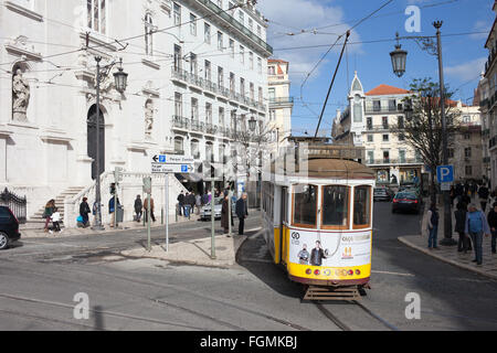 Portugal, city of Lisbon, Chiado, vintage tram nr 28 on the left Church Igreja do Loreto - Stock Photo