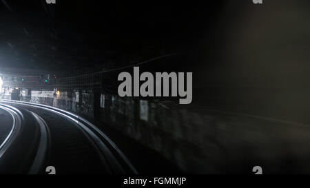 Fast subway train under blue and yellow light - Stock Photo