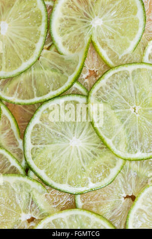 background made with slices of lime - Stock Photo