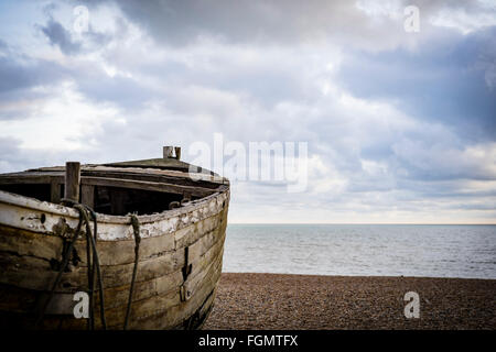 Old wooden fishing boat on the beach,Brighton ,UK - Stock Photo