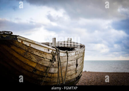 Old wooden fishing boat on Brighton beach,Sussex, UK - Stock Photo