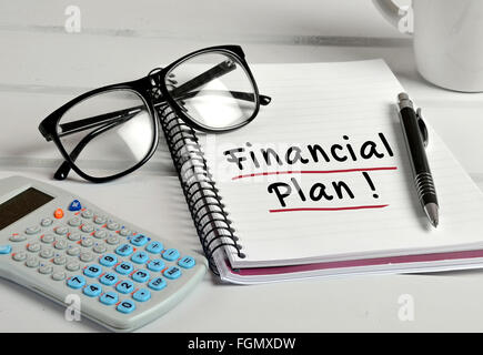Financial Plan word on notebook page - Stock Photo