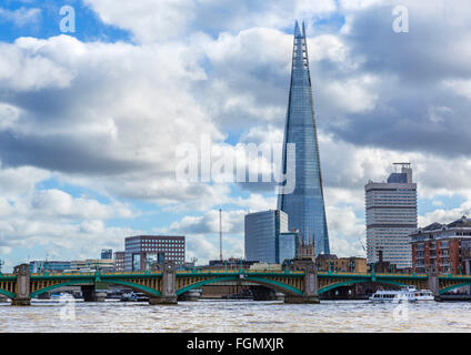 View over River Thames to Southwark Bridge with The Shard behind, Southwark, London, England, UK - Stock Photo