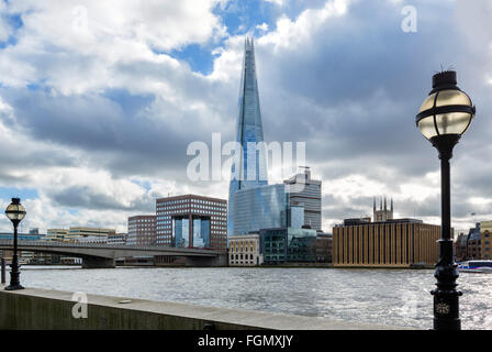 View over River Thames to London Bridge with The Shard behind, Southwark, London, England, UK - Stock Photo