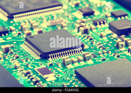 Electronic circuit board close up. Green PCB - Stock Photo