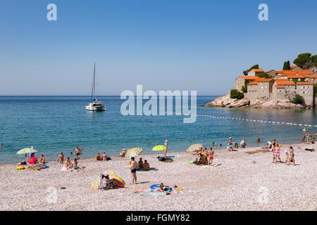 Sveti Stefan, near Budva, Montenegro.  Beach in front of the island. - Stock Photo