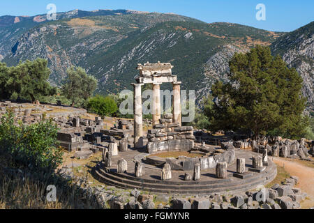 Delphi, Phocis, Greece.  The tholos, dating from around 380-360 BC, beside the Sanctuary of Athena Pronaia. - Stock Photo