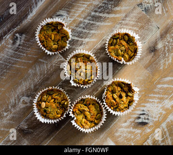 Handmade Savoury Blue Cheese Cupcakes on vintage wooden background, aerial top view - Stock Photo