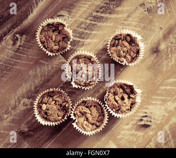 Handmade Savoury Blue Cheese Cupcakes on vintage wooden background, aerial top view, toned filter applied - Stock Photo