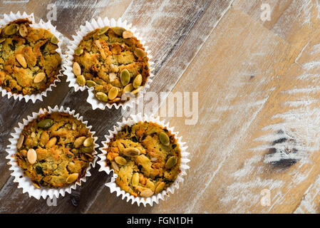 Handmade Savoury Blue Cheese Cupcakes on vintage wooden background, aerial top view, available copy space on the - Stock Photo