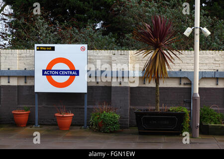 Pot plants and sign on platform at Acton Central Overground station, Acton, London, England - Stock Photo