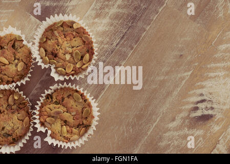 Handmade Savoury Blue Cheese Cupcakes on vintage wooden background, aerial top view, toned filter applied, available - Stock Photo